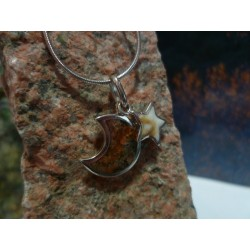 Sterling silver pendant with Rouge de Porto and the Eye of Saint Lucia