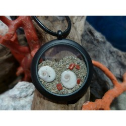 Black steel pendant eye of Saint Lucia and red coral
